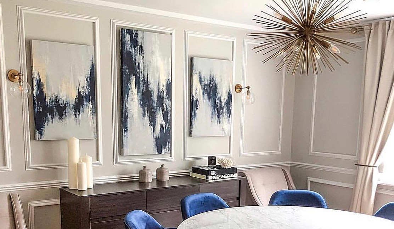 Trio of artwork in meeting space